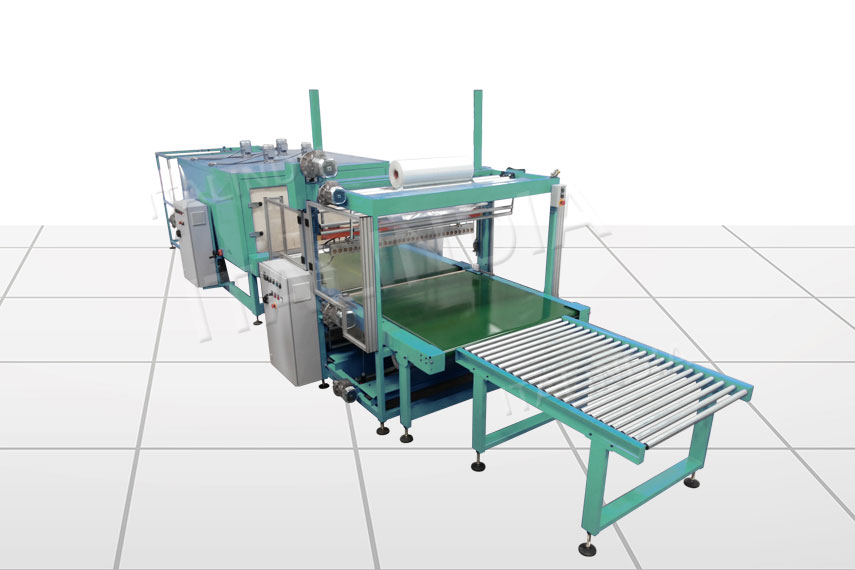 shrink wrapping machine with multiple tracks for feeding products